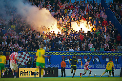 OSIJEK, CROATIA - Sunday, May 23, 2010: Croatia's supporters light a flare as they celebrate scoring against Wales during the International Friendly match at the Stadion Gradski Vrt. (Pic by David Rawcliffe/Propaganda)