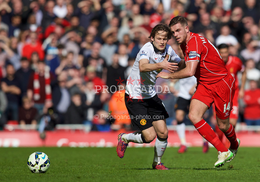 LIVERPOOL, ENGLAND - Sunday, March 22, 2015: Liverpool's captain Jordan Henderson in action against Manchester United's Daley Blind during the Premier League match at Anfield. (Pic by David Rawcliffe/Propaganda)