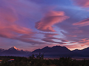 "The last rays of sunset brighten lenticular clouds with pink and magenta color over Aoraki / Mount Cook, (3755 meters or 12,349 feet) in Aoraki / Mount Cook National Park, South Island, New Zealand. In 1990, UNESCO honored Te Wahipounamu - South West New Zealand as a World Heritage Area. Published in ""Light Travel: Photography on the Go"" by Tom Dempsey 2009, 2010."