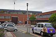 A taxi pulls up in the entrance road to HMP Holloway, the main womens prison in London.
