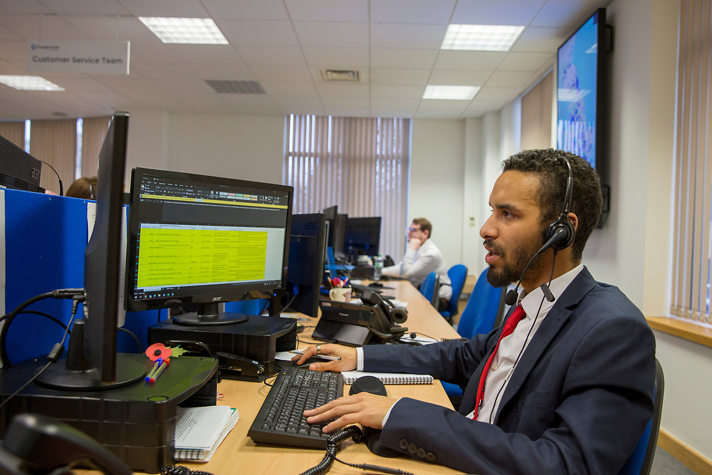 A customer service team member takes a call in the Chargemaster 24-hour Customer Service centre in the United Kingdom. Chargemaster assists customers with any issues they may have with charging their electric vehicles at one of the POLAR network charging points. <br /> (photo by Andrew Aitchison / In pictures via Getty Images)
