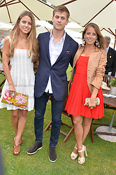 IRENE FORTE, her brother CHARLES FORTE and sister LYDIA FORTE at the Cartier Queen's Cup Final polo held at Guards Polo Club, Smith's Lawn, Windsor Great Park, Egham, Surrey on 15th June 2014.
