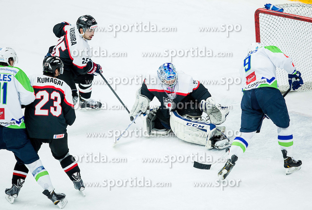 Tomaz Razingar of Slovenia scores against Yuto Ito of Japan during ice-hockey friendly match between National teams of Slovenia and Japan, on April 10, 2015 in Arena Podmezakla, Jesenice, Slovenia. Photo by Vid Ponikvar / Sportida