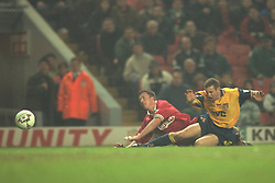 Liverpool, England - Wednesday, November 27th, 1996: Liverpool's Robbie Fowler is brought down for a penalty by Arsenal's Nigel Winterbiurn during the 4-2 victory over Arsenal during the 4th Round of the League Cup at Anfield. (Pic by David Rawcliffe/Propaganda)