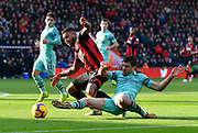 Joshua King (17) of AFC Bournemouth is tackled by Sokratis Papastathopoulos (5) of Arsenal during the Premier League match between Bournemouth and Arsenal at the Vitality Stadium, Bournemouth, England on 25 November 2018.