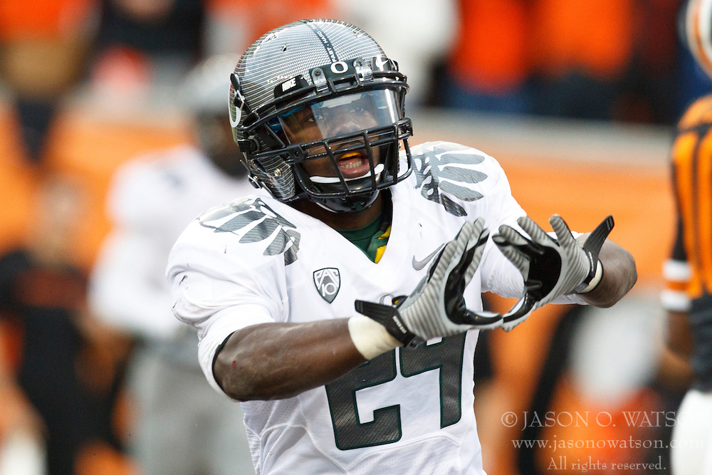 December 4, 2010; Corvallis, OR, USA;  Oregon Ducks running back Kenjon Barner (24) celebrates after scoring a touchdown against the Oregon State Beavers during the fourth quarter at Reser Stadium.  Oregon defeated Oregon State 37-20.