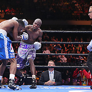 Willie Nelson (C) throws a punch to the head of Tony Harrison during their Premier Boxing Champions boxing match on ESPN at the USF Sun Dome, on Saturday, July 11, 2015 in Tampa, Florida.  Nelson won the match by TKO. (AP Photo/Alex Menendez)