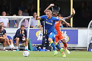 AFC Wimbledon midfielder Dean Parrett (18) dribbling and taking on Shrewsbury Town midfielder Abu Ogogo (8) during the EFL Sky Bet League 1 match between AFC Wimbledon and Shrewsbury Town at the Cherry Red Records Stadium, Kingston, England on 12 August 2017. Photo by Matthew Redman.