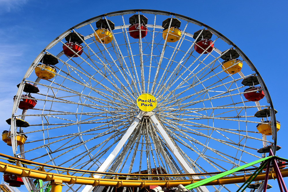 Santa Monica Pier Ferris Wheel in Santa Monica, California <br /> This giant Ferris wheel is one of 13 rides you&rsquo;ll find on the Santa Monica Pier.  In addition to the Pacific Wheel, the amusement park also includes an arcade and restaurants.  Pacific Park has operated since 1996.