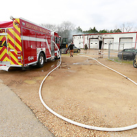 THOMAS WELLS | BUY at PHOTOS.DJOURNAL.COM<br /> Fire departments from Okolona, Shannon and Wren respond to a fire at Jacobs Garage on Hwy 245 in Okolona on Wednesday.