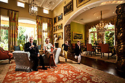 Brian and Eileen Burns, in the living room of their Palm Beach home.  With grandsons Liam (older) and Oscar (younger).