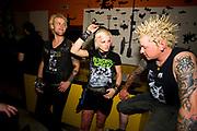 Three Punks relax at Municipal Waste gig, at Louvre. Prague, Czech Republic. 21 & 22/05/07