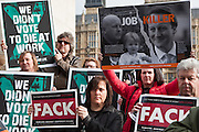 FACK and Hazard posters and banners. Members of the Trade Union Coordinating Group gathered for a Health and Safety lobby of Parliament on College Green opposite Parliament, London.