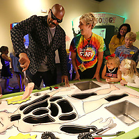 Steve Harvey plays a quick game of Operation with Kathy Tucker, Director of HealthWorks in Tupelo, as he is given a tour of HealthWorks Friday afternoon in Tupelo.