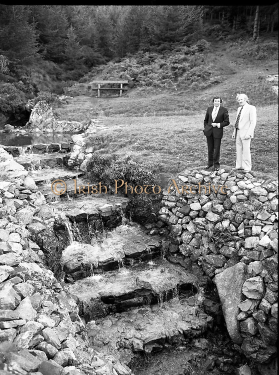 "The Carlingford Oyster Festival.1982.19.08.1982..08.19.1982.19th August 1982..Pictures and Images of the Carlingford Oyster Festival... The Minister For Fisheries and Forestry Mr Brendan Daly officially opened  The Carlingford Oyster Festival. The Chairman of the organising committee was Mr. Joe McKevitt..""The Oyster Pearl"" was Ms Deirdre McGrath..The Minister takes in the local sites accompanied by Mr McKevitt."