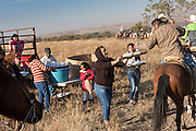 Villagers hand out free sandwiches to hundreds of Mexican cowboys as they ride past during the annual Cabalgata de Cristo Rey pilgrimage January 5, 2017 in La Trinidad, Guanajuato, Mexico. Thousands of Mexican cowboys and horse take part in the three-day ride to the mountaintop shrine of Cristo Rey stopping along the way at shrines and churches.