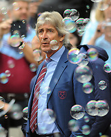 Football - 2019 / 2020 Premier League - West Ham United vs. Manchester United<br /> <br /> West ham Manager, Manuel Pellegrini watches the game through a sea of Bubbles, at The London Stadium.<br /> <br /> COLORSPORT/ANDREW COWIE