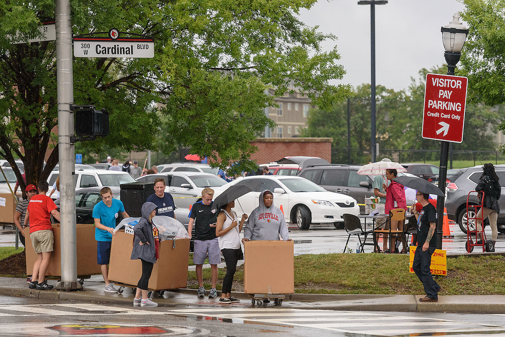 Students and families wait to cross Cardinal Boulevard to move their stuff into Bettie Johnson Hall as first-time students move in to Belknap Campus dormitories Wednesday during University of Louisville's Welcome Week. Aug. 17, 2016