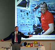 Former Astronaut Mark Brown stands in front of a slide taken in space as he explains how he dressed in space during the 5th Annual TechFest at Sinclair Community College, Saturday afternoon.