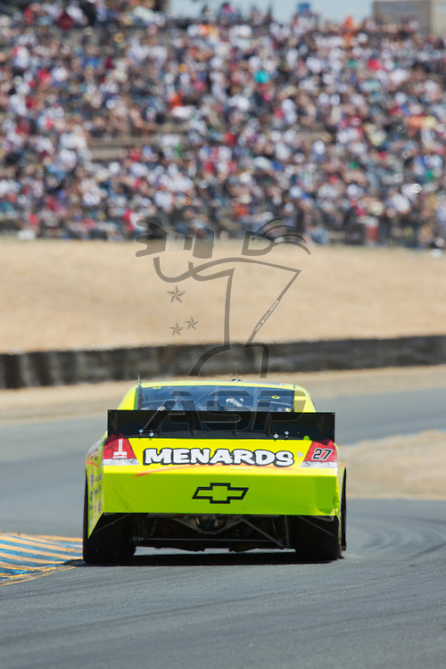SONOMA, CA - JUN 24, 2012:  Paul Menard (27) brings his car through the turns during the Toyota Save Mart 350 at the Raceway at Sonoma in Sonoma, CA.