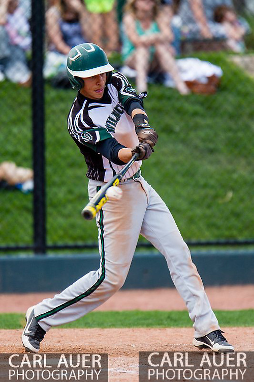May 17th 2013: Fleming Wildcats senior Tanner Serrato (9) connedts with the ball in the CHSAA 1A Baseball final against the Holly Wildcats at All Star Park in Lakewood, Colorado