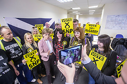 First Minister of Scotland and leader of the SNP Nicola Sturgeon, out on the election trail to make sure people are out voting today, May 7, 2015 in Glasgow, Scotland. In the SNP office in Westmuir Street, with candidate Natalie McGarry (red dress).