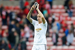 Jonjo Shelvey of Swansea City applauds the travelling fans after the game ends 1-1 - Photo mandatory by-line: Rogan Thomson/JMP - 07966 386802 - 27/08/2014 - SPORT - FOOTBALL - Sunderland, England - Stadium of Light - Sunderland v Swansea City - Barclays Premier League.