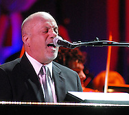 PHILADELPHIA - JANUARY 26: Musician Billy Joel performs during the 151st Anniversary of the Academy of Music January 26, 2008 in Philadelphia, Pennsylvania. The Philadelphia Orchestra debuted one of Billy Joel's original compositions and Joel performed for the first time with a major orchestra. (Photo by William Thomas Cain/Getty Images)