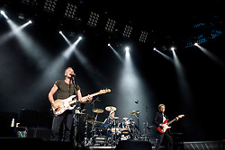 The Police (lead vocalist Sting (Gordon Sumner), drummer Stewart Copeland, and guitarist Andy Summers) performed in concert at the John Paul Jones Arena in Charlottesville, VA on November 6, 2007.