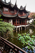 View of the pond and Yangshan Hall in Yu Yuan Gardens Shanghai, China