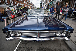 © Licensed to London News Pictures. 17/06/2018. LONDON, UK. A 1966 Mercury Park Lane Convertible at the 6th Annual Classic and Supercar Pageant held at St John's Wood High Street.  Traditionally taking place on Fathers' Day, the show brings together an eclectic mix of exotic and popular vehicles attracting visitors young and old and raises funds for the local charity, The St John's Hospice.  Photo credit: Stephen Chung/LNP