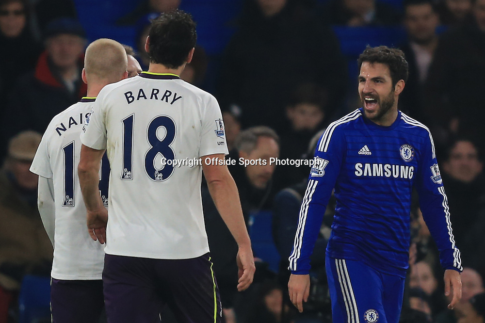 11 February 2015 - Barclays Premier League - Chelsea v Everton - Cesc Fabregas of Chelsea laughs at Gareth Barry of Everton after he is shown a 2nd yellow card and sent off - Photo: Marc Atkins / Offside.