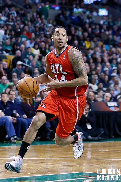 08 March 2013: Atlanta Hawks point guard Devin Harris (34) dribbles during the Boston Celtics 107-102 OT victory over the Atlanta Hawks at the TD Garden, Boston, Massachusetts, USA.