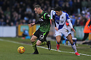 Doncaster Rovers Alfie Beestin (22) battles for the ball against  Bristol Rovers Daniel Leadbitter (2) during the EFL Sky Bet League 1 match between Bristol Rovers and Doncaster Rovers at the Memorial Stadium, Bristol, England on 23 December 2017. Photo by Gary Learmonth.
