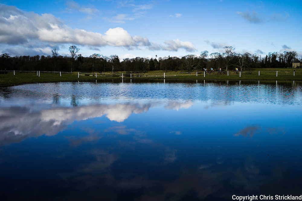Clouds are reflected in flooded parts of the racecourse at Friars Haugh, as horses race along the banks of the River Tweed.