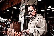 Grocery shopper at Chinese market on Eastdale, Toronto, Canada