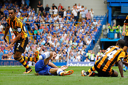 Chelsea's Eden Hazard is tackled by Hull City's Sone Aluko  - Photo mandatory by-line: Mitchell Gunn/JMP - Tel: Mobile: 07966 386802 18/08/2013 - SPORT - FOOTBALL - Stamford Bridge - London -  Chelsea v Hull City - Barclays Premier League