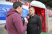 Forest Green Rovers manager, Mark Cooper giving a radio interview prior to kick off during the Vanarama National League first leg play off match between Dagenham and Redbridge and Forest Green Rovers at the London Borough of Barking and Dagenham Stadium, London, England on 4 May 2017. Photo by Shane Healey.