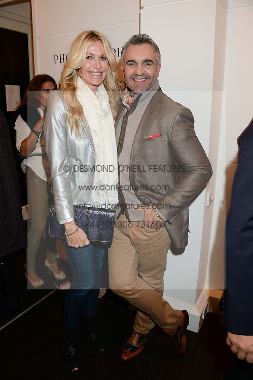 MELISSA ODABASH and interior designer MARTYN LAWRENCE BULLARD at a private view of Photographs by Julian Lennon held at The Little Black Gallery, 13A Park Walk, London SW10 on 17th September 2013.
