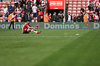 Football - 2017 / 2018 Premier League - Southampton vs. Chelsea<br /> <br /> A dejected Shane Long of Southampton sits alone after the final whistle at St Mary's Stadium Southampton<br /> <br /> COLORSPORT/SHAUN BOGGUST