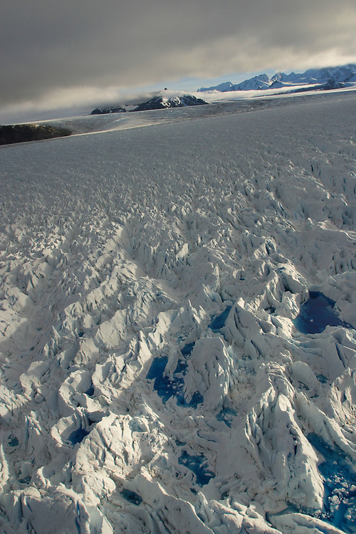 Meltwater pools on the surface of the San Rafael glacier in Patagonia, Chile, Feb. 1, 2004. Daniel Beltra/Greenpeace.