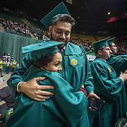 FAIRFAX, VA -DEC21: Emerita Ayala gets a hug from cousin Merlyn Flores, during their graduation from George Mason University in Fairfax, Virginia, December 21, 2016. Emerita started college as a teenage mom at 18, with her 3-year-old son at community college. She got help through a nonprofit called Generation Hope that provides scholarships and mentoring to teenage moms, and earned her bachelors degree from George Mason University. (Photo by Evelyn Hockstein/For The Washington Post)