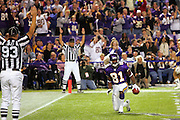 MINNEAPOLIS - NOVEMBER 21:  Wide receiver Nate Burleson #81 of the Minnesota Vikings catches a six yard touchdown pass to start the Vikings fourth quarter comeback win against the Detroit Lions at the Hubert H. Humphrey Metrodome on November 21, 2004 in Minneapolis, Minnesota. The Vikings defeated the Lions 22-19. ©Paul Anthony Spinelli  *** Local Caption *** Nate Burleson