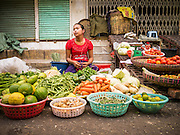 16 JUNE 2013 - YANGON, MYANMAR:  A vegetable vendor in a market in Yangon. Yangon, formerly Rangoon, is the largest city in Myanmar. It is the former capital of the Southeast Asian country. It's still Myanmar's economic capital.     PHOTO BY JACK KURTZ