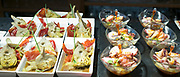 Spanish tapas, pintxos, artichokes, red pepper, seafood in tapas bar restaurant, Logrono, Basque Country, Spain