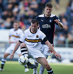 Dumbarton's Garry Fleming and Falkirk's Owain Tudor Jones.<br /> half time : Falkirk 1v 0 Dumbarton, Scottish Championship game played 20/9/2014 at The Falkirk Stadium .