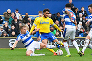 Tyler Roberts (11 of Leeds United is tackled by Jack Bidwell (3) of Queens Park Rangers during the The FA Cup 3rd round match between Queens Park Rangers and Leeds United at the Loftus Road Stadium, London, England on 6 January 2019.