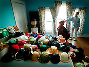 """Essie Mae Lewis McElory, 82, New Liberty Missionary Baptist Church, (200 plus hats) and her daughter, Freddie Wilson-Colbert. """"I just like hats, I like to wear hats, I like to buy hats, I just love pretty hats and I like a whole lotta hats and thatÕs why I have a whole lotta hats. Cause thatÕs what I like. IÕm just a hat fanatic."""""""