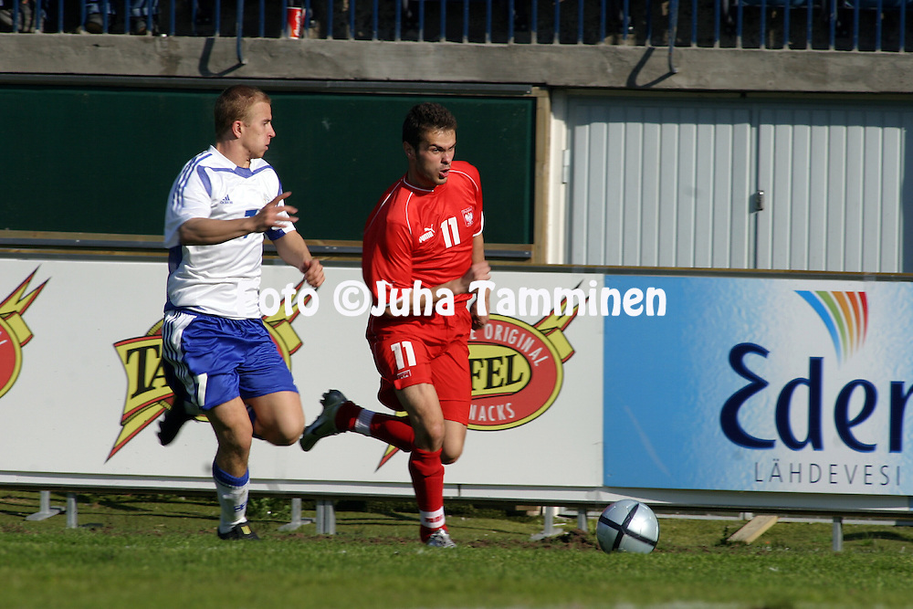 27.05.2004, Veritas Stadion, Turku, Finland..Under-21 Friendly International match, Finland v Poland.Kari Arkivuo (Finland U-21) v Piotr Brozek (Poland U-21).©Juha Tamminen