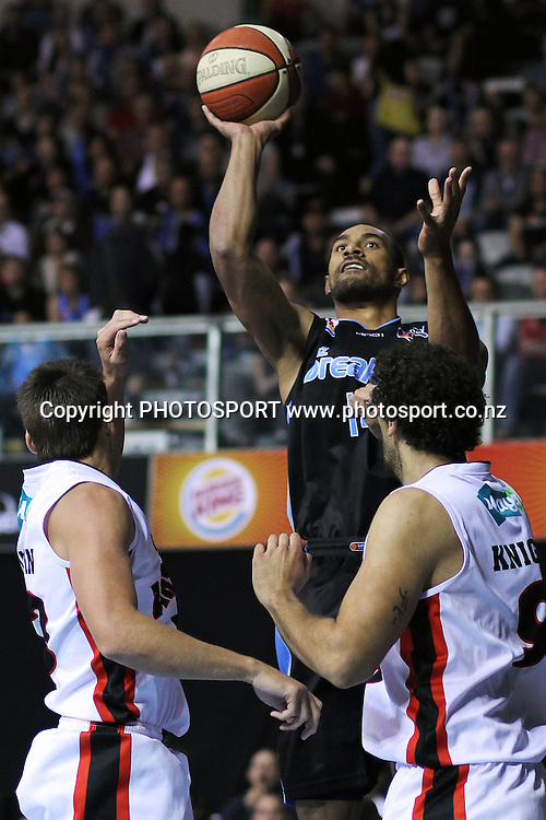 Breakers' Mika Vukona takes a shot over Wildcats' Matthew Knight and Damian Martin. iinet ANBL, Semi-Finals Game 1, New Zealand Breakers vs Perth Wildcats, North Shore Events Centre, Auckland, New Zealand. Thursday 7th April 2011. Photo: Anthony Au-Yeung / photosport.co.nz